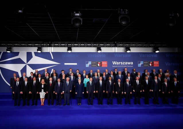 NATO heads of state and other leaders participate in a family photo at the NATO Summit in Warsaw, Poland July 8, 2016.