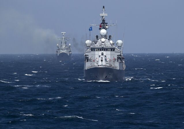 Turkish NATO warship TCG Turgutreis, foreground, maneuvers on the Black Sea after leaving the port of Constanta, Romania, Monday, March 16, 2015.