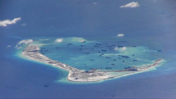 Chinese dredging vessels in the waters around Mischief Reef in the disputed Spratly Islands in the South China Sea, photographed by a USN surveillance aircraft in 2015 - Sputnik International
