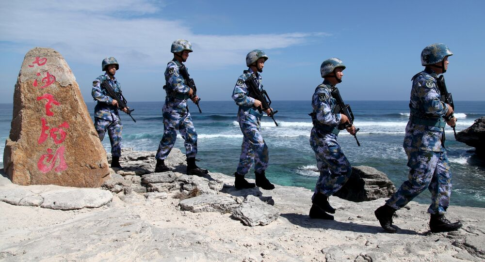 Soldiers of China's People's Liberation Army (PLA) Navy patrol at Woody Island, in the Paracel Archipelago, which is known in China as the Xisha Islands, January 29, 2016.