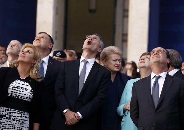 Croatia's President Kolinda Grabar-Kitarovic, Poland's President Andrzej Duda, NATO Secretary-General Jens Stoltenberg,Lithuania's President Dalia Grybauskaite, German Chancellor Angela Merkel and France's President Francois Hollande react as they observe a fly past during the NATO Summit in Warsaw, Poland July 8, 2016.