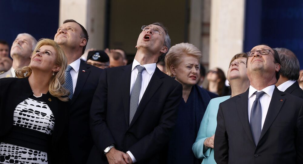 Croatia's President Kolinda Grabar-Kitarovic, Poland's President Andrzej Duda, NATO Secretary-General Jens Stoltenberg,Lithuania's President Dalia Grybauskaite, German Chancellor Angela Merkel and France's President Francois Hollande react as they observe a fly past during the NATO Summit in Warsaw, Poland July 8, 2016.