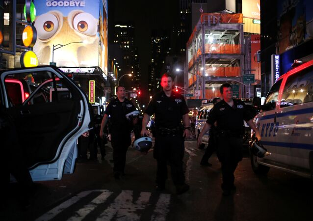 NYPD officers keep an eye on protesters as they go through Times Square taking part in a protest against the killing of Alton Sterling, Philando Castile and in support of Black Lives Matter during a march along Manhattan's streets in New York July 8, 2016.