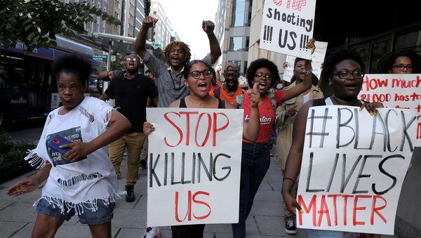 Demonstrators with Black Lives Matter march during a protest in Washington, U.S., July 8, 2016. - Sputnik International