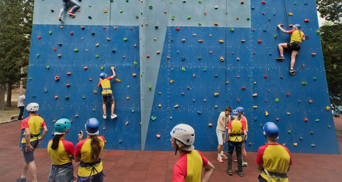 Children at a new climbing gym on the anniversary of the Artek International Children's Center in Crimea.