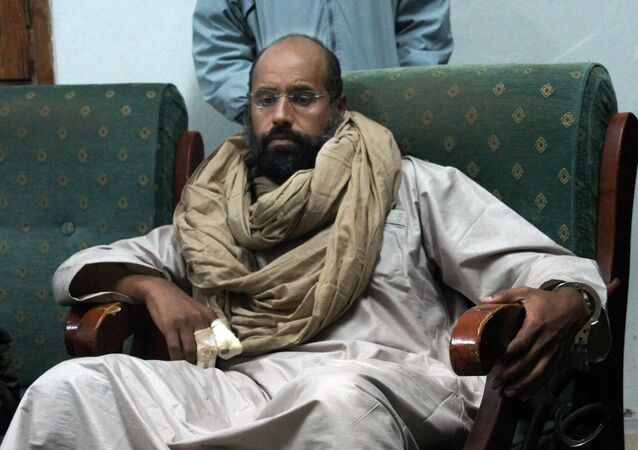 In this Saturday, Nov. 19, 2011 file photo, Seif al-Islam is seen after his capture in the custody of revolutionary fighters in Zintan.