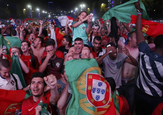 Portugal fans react at the fan zone after their team beat France in the Portugal v France EURO 2016 final soccer match in Paris, France, July 10, 2016