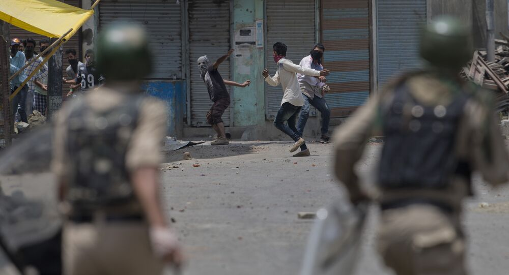 Kashmiri Muslim protesters throw bricks and rocks at Indian paramilitary soldiers in Srinagar, Indian controlled Kashmir, Sunday, July 10, 2016