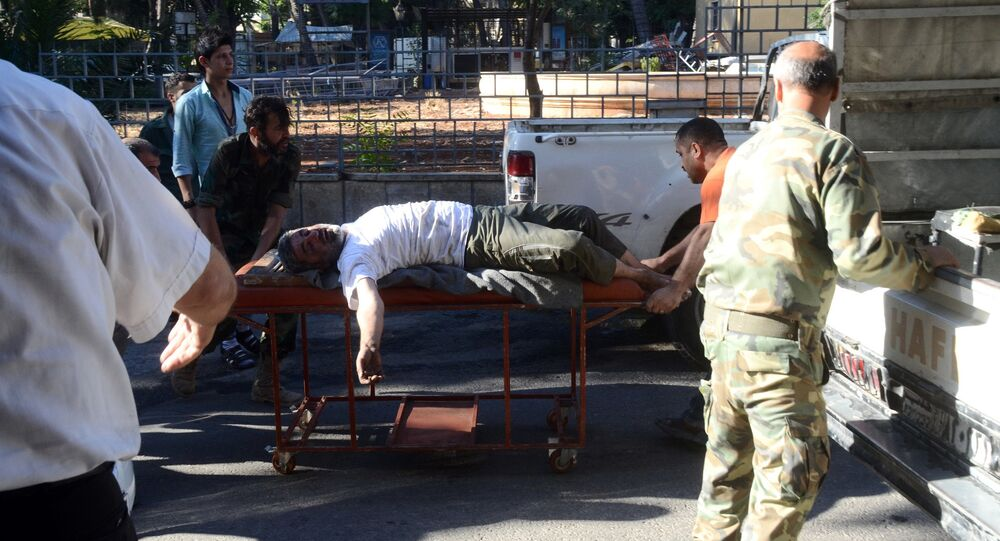 A wounded Syrian man is wheeled on a gurney into a hospital in the northern Syrian city of Aleppo (File)