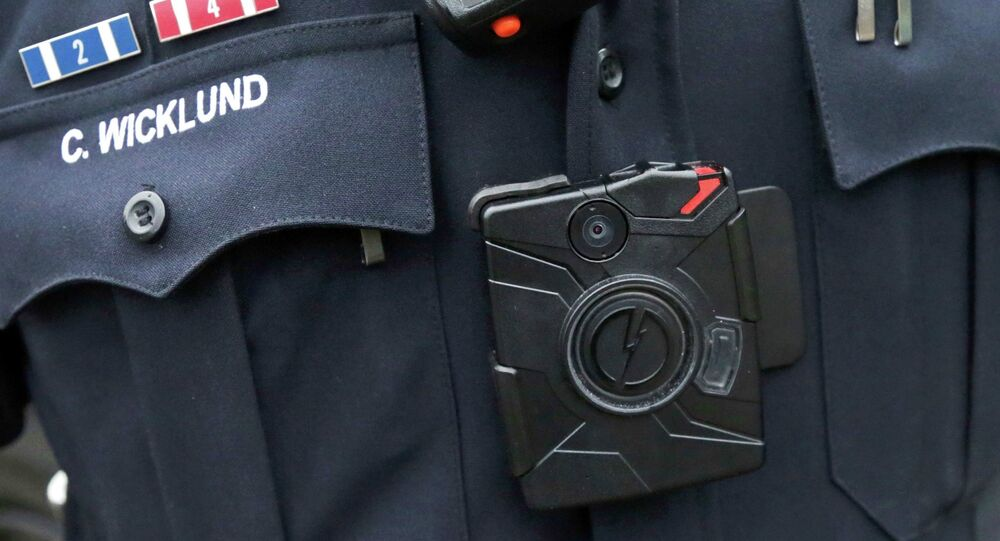 Police officer wearing a body camera beneath his microphone