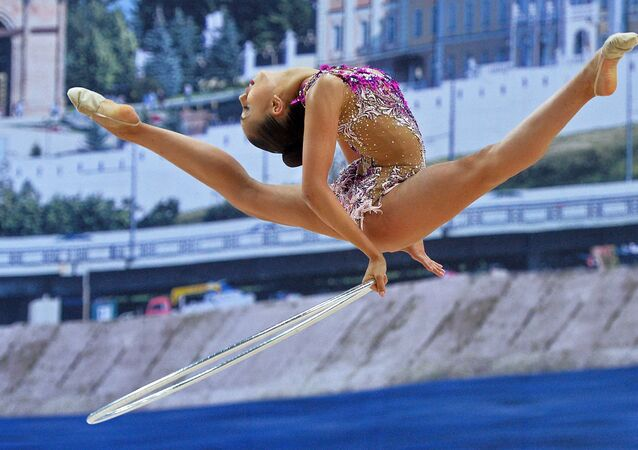 Russia's Margarita Mamun performs a hoop routine during individual all-around at the 2016 Rhythmic Gymnastics World Cup Series in Kazan, Russia