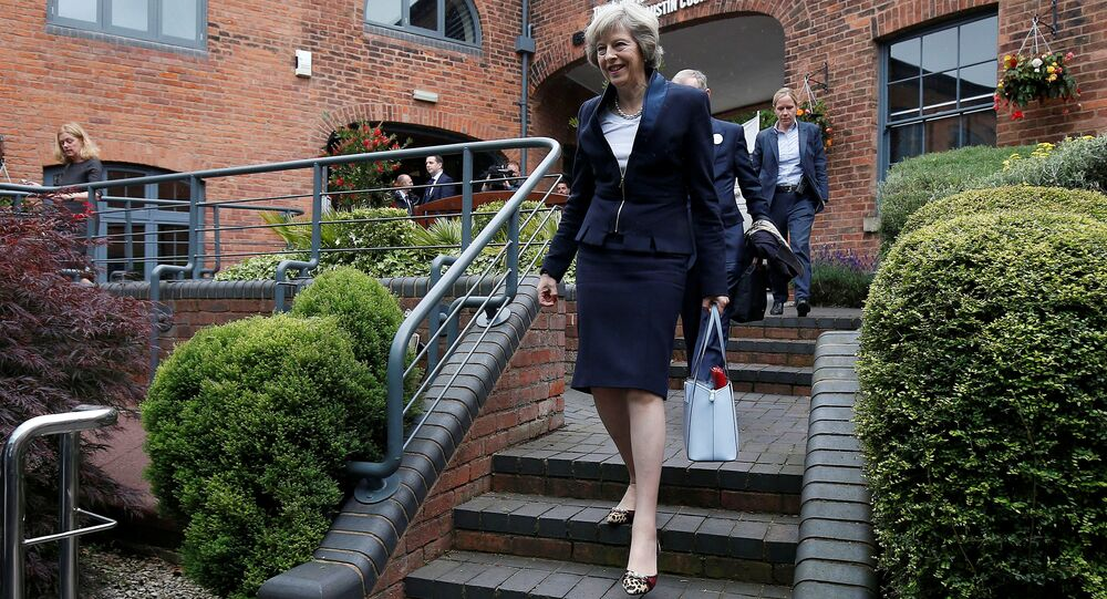 Britain's Home Secretary Theresa May arrives to speak during her Conservative party leadership campaign at the Institute of Engineering and Technology in Birmingham, England, Britain July 11, 2016