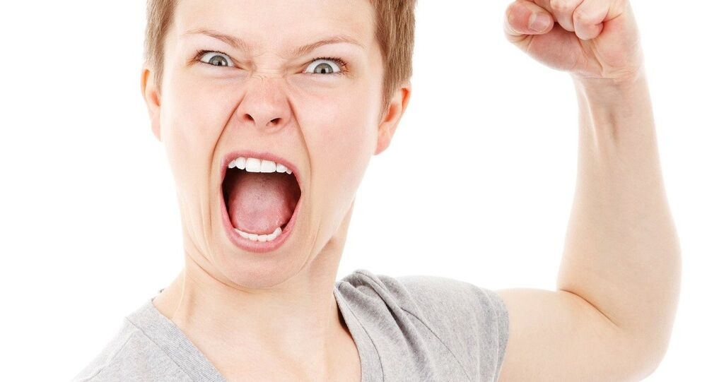 A female model expressing anger