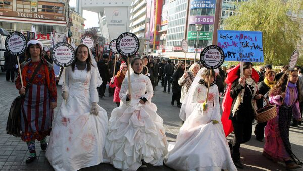 Women activists, some dressed in wedding gowns representing child brides forced into marriage, hold placards that read End violence to protest rape and domestic violence. - Sputnik International