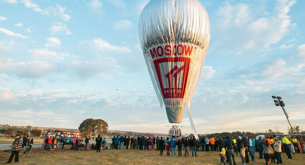 The balloon of Russian adventurer Fedor Konyukhov is surrounded by onlookers before the start of his attempt to break the world record for a solo hot-air balloon flight around the globe near Perth, Australia, in this handout image received July 12, 2016