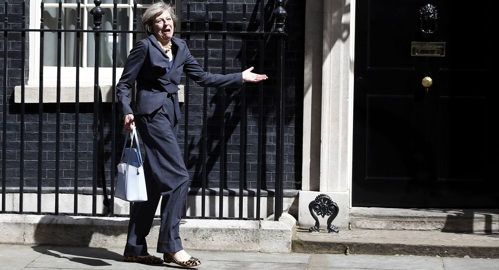 Britain's Home Secretary Theresa May, who is due to take over as prime minister on Wednesday, leaves after a cabinet meeting at number 10 Downing Street, in central London, Britain July 12, 2016.