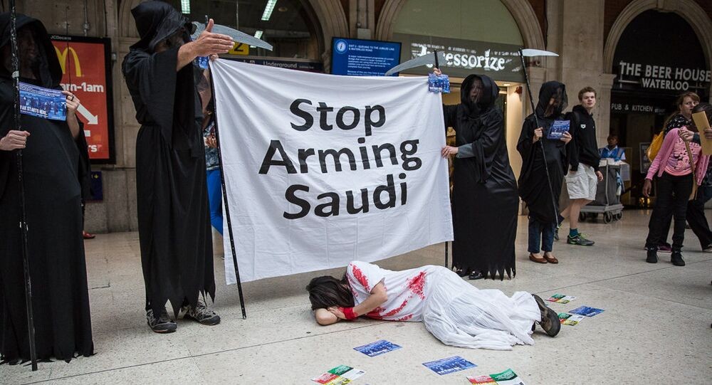 Human rights campaigners protest against Farnborough International arms fair.