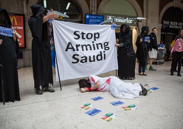 Human rights campaigners protest against Farnborough International arms fair.
