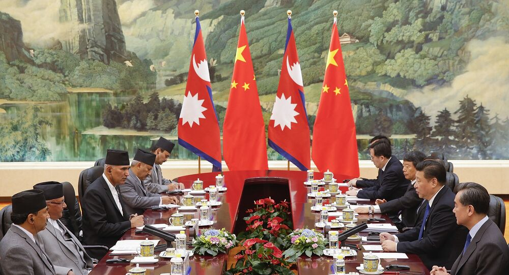 Chinese President Xi Jinping (2nd R) attends a meeting with Nepalese Prime Minister K.P. Sharma Oli (2nd L) at the Great Hall of the People in Beijing on March 21, 2016