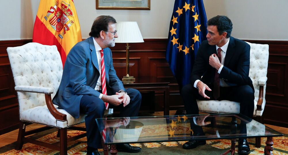 Spain's acting Prime Minister Mariano Rajoy (L) listens to Spain's Socialist Party (PSOE) leader Pedro Sanchez during their meeting at Spanish parliament in Madrid, Spain, July 13, 2016