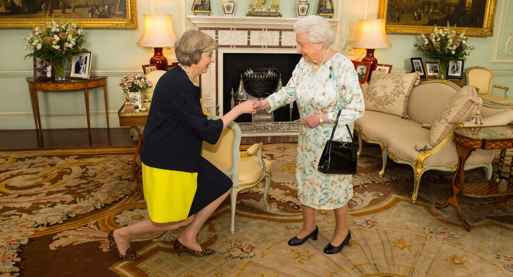 Queen Elizabeth II welcomes Theresa May, left, at the start of an audience in Buckingham Palace, London, where she invited the former Home Secretary to become Prime Minister and form a new government, Wednesday July 13, 2016
