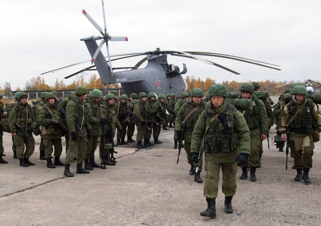 Paratroopers gathered round a Mil Mi-26 helicopter during drills involving the airforce of the Western Military District, Pskov Region, Russia