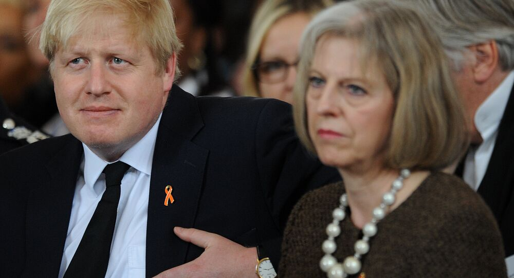 Boris Johnson (C) and Theresa May (R) attend a memorial service church in central London.