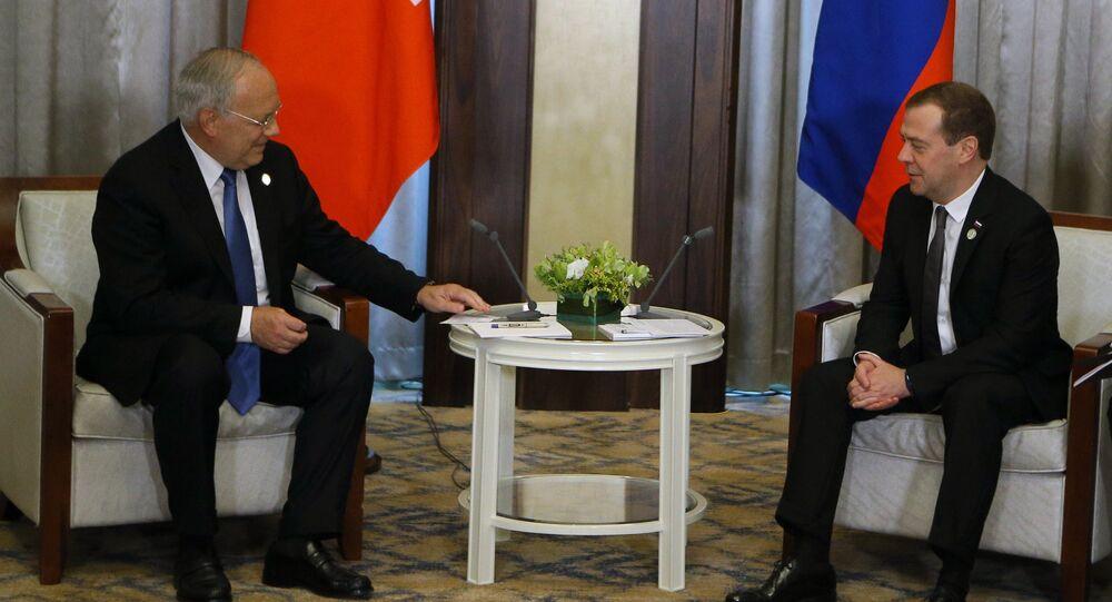 Russian Prime Minister Dmitry Medvedev and Swiss President Johann Schneider-Ammann on the sidelines of the Asia–Europe Meeting in Mongolia.