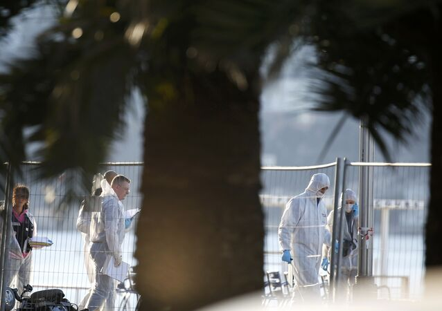 French forensic police continue their investigation as they gather clues the day after a truck at high speed ran into a crowd killing scores celebrating the Bastille Day July 14 national holiday on the Promenade des Anglais in Nice, France, July 15, 2016.