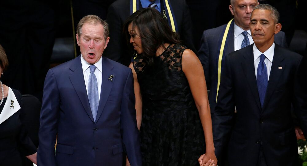 Former president George W. Bush (L), First Lady Michelle Obama (C) and U.S. President Barack Obama sing during a memorial service following the multiple police shootings in Dallas, Texas, U.S., July 12, 2016.