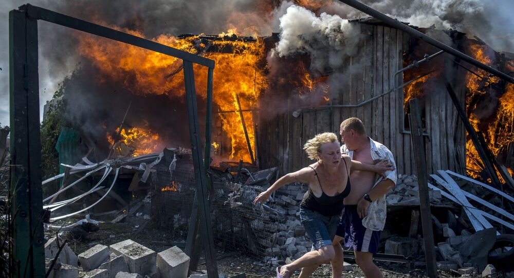 Valery Melnikov's photograph showing residents of the village of Lugansk fleeing from an airstrike by the Ukrainian armed forces