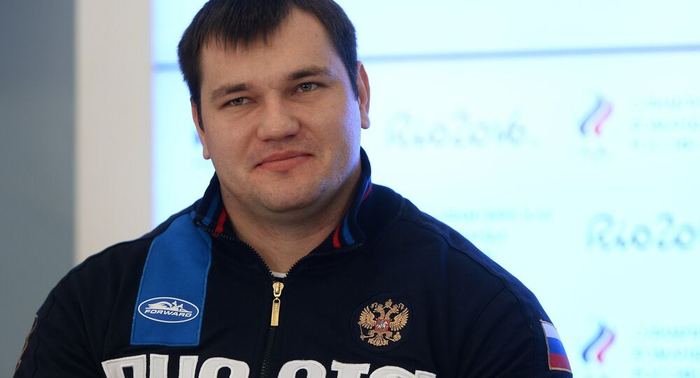 Russian weightlifter Alexei Lovchev at a news conference by the Russian Weightlifting Federation in Moscow.