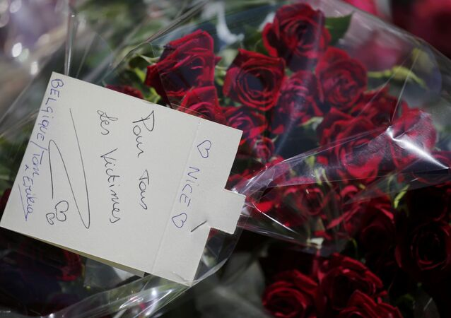 A bouquet of flowers with the message, To All the Victims is seen as people pay tribute near the scene where a truck ran into a crowd at high speed killing scores and injuring more who were celebrating the Bastille Day national holiday, in Nice, France, July 15, 2016.