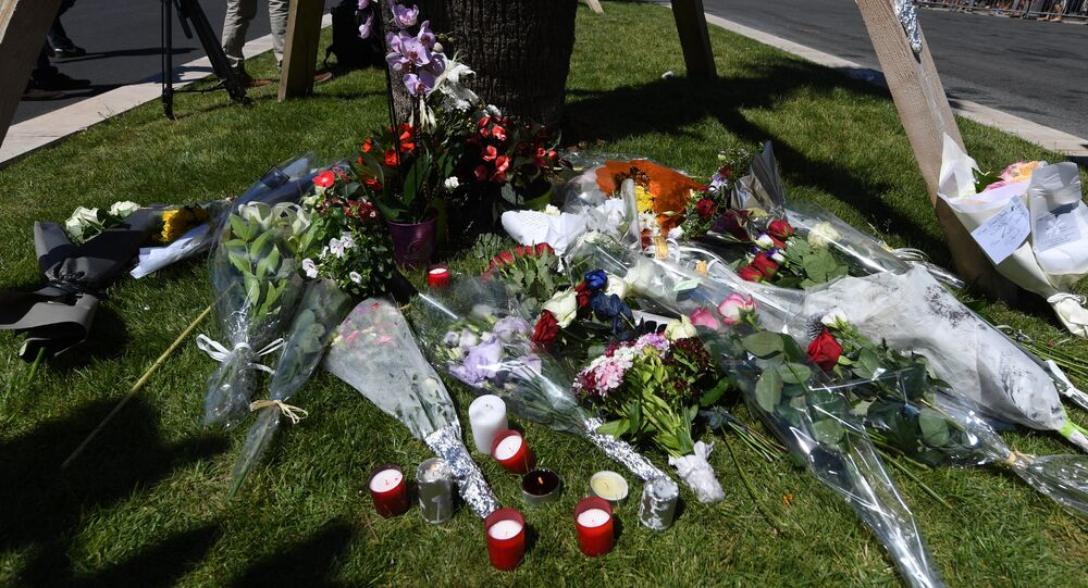 A photo taken on July 15, 2016 shows flowers and candles placed near the site in Nice where a gunman smashed a truck into a crowd of revellers celebrating Bastille Day, killing at least 84 people.