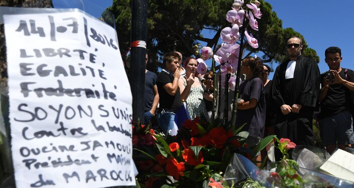 A sign reading Liberty, equality, fraternity, let us unite against barbarism is placed on July 15, 2016 at a makeshift memorial near the site in Nice where a gunman smashed a truck into a crowd of revellers celebrating Bastille Day, killing at least 84 people.
