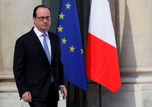 French President Francois Hollande leaves the Elysee Palace in Paris, France, July 15, 2016, after attending an emergency defence meeting the day after the Bastille Day truck attack in Nice.