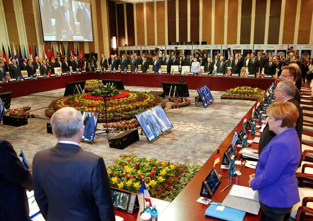Leaders stand for a minute of silence for the victims of a deadly attack in the French city of Nice, before the opening session of the Asia-Europe Meeting (ASEM) summit in Ulaanbaatar, Mongolia, July 15, 2016