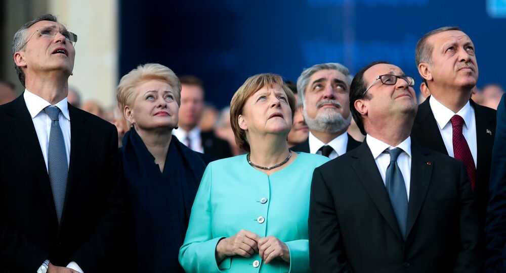 From left, NATO Secretary General, Lithuanian President Dalia Grybauskaite, German Chancellor Angela Merkel, French President Francois Hollande and Turkey's President Recep Tayyip Erdogan watch a fly-past by NATO air forces planes during the NATO summit in Warsaw, Poland, Friday, July 8, 2016.