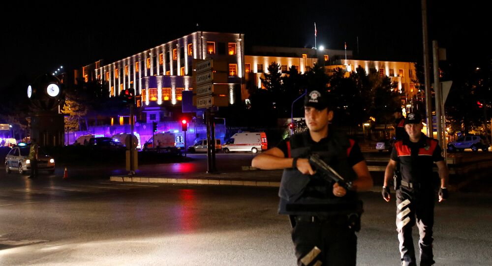 Police officers stand guard near the Turkish military headquarters in Ankara, Turkey.