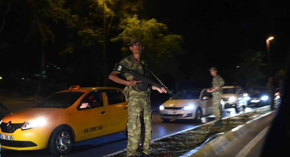 Turkish security officer stands on guard on the side of the road on July 15, 2016 in Istanbul, during a security shutdown of the Bosphorus Bridge.