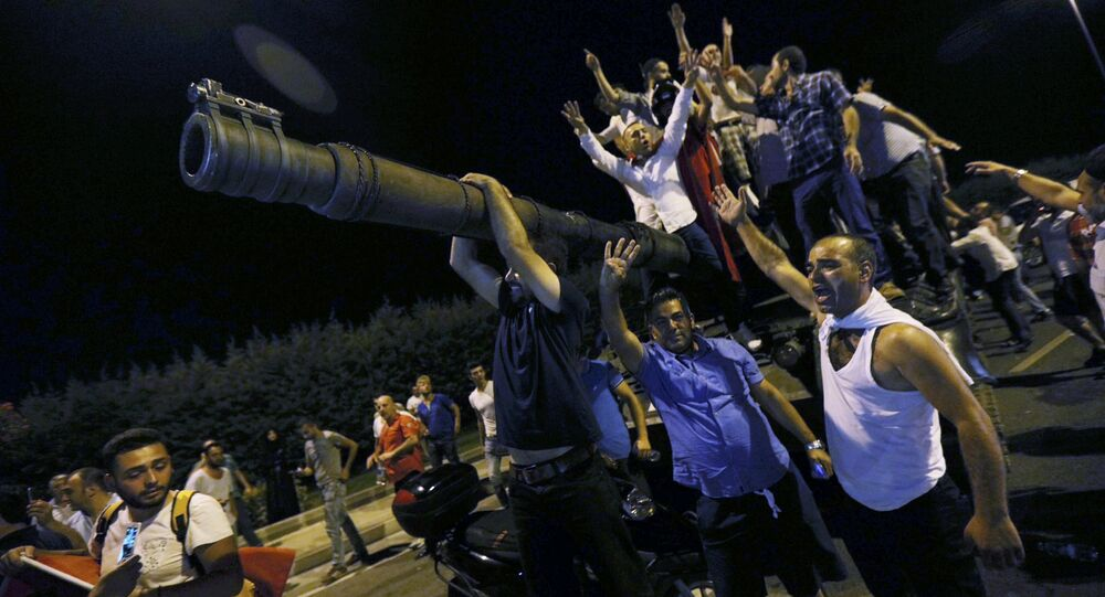 People Stand On A Turkish Army Tank At Ataturk Airport In Istanbul