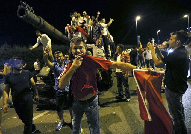 Outside Ataturk Airport In Istanbul People Stand On A Turkish Army Tank
