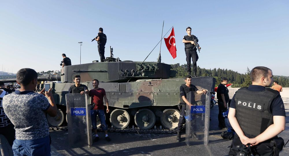 People pose with policemen after troops involved in the coup surrendered on the Bosphorus Bridge in Istanbul, Turkey July 16, 2016.