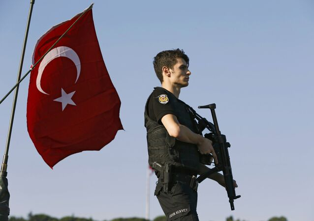A policeman stands atop of a military armored vehicle after troops involved in the coup surrendered on the Bosphorus Bridge in Istanbul, Turkey July 16, 2016.