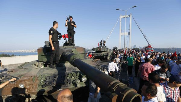 Policemen stand on a military vehicle after troops involved in the coup surrendered on the Bosphorus Bridge in Istanbul, Turkey July 16, 2016. - Sputnik International