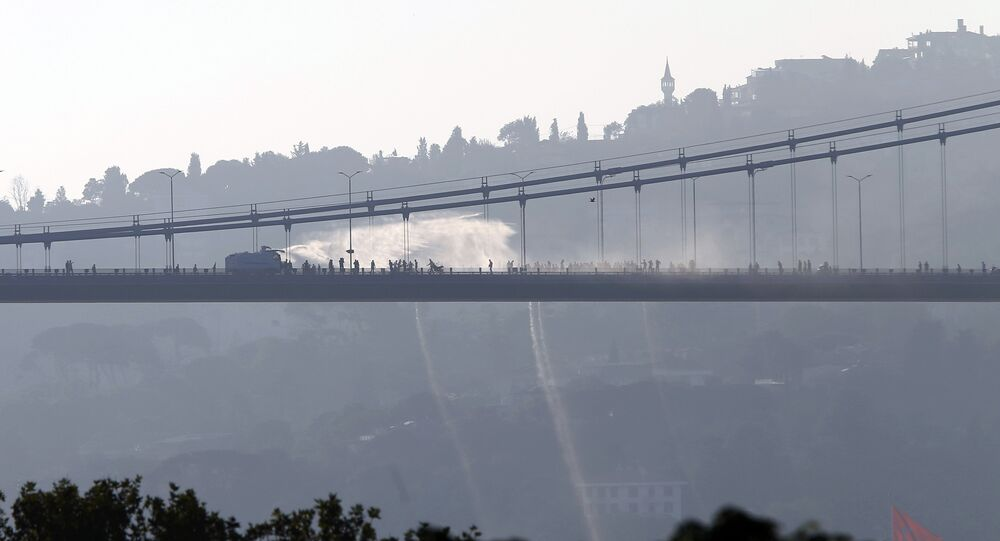 A police armored vehicle uses a water cannon to disperse anti-government forces on Bosphorus Bridge in Istanbul, Turkey, July 16, 2016.