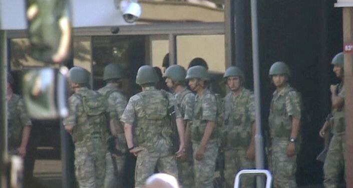 still image from video shows armed soldiers waiting at the entrance of TRT state television as they prepare to surrender to the police after a failed coup attempt, in Istanbul, Turkey July 16, 2016