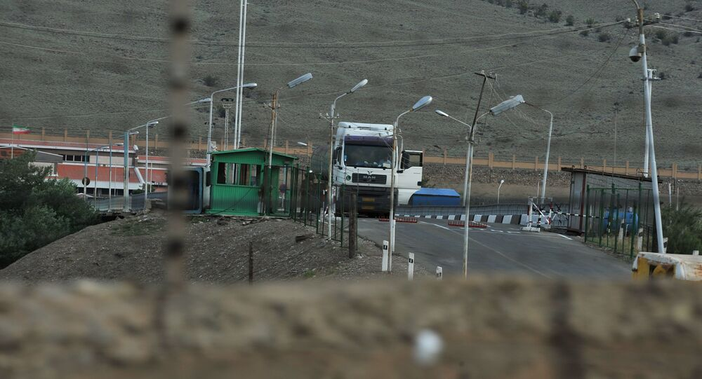 A truck waits at a check point on the Iranian side of the border near the Armenian town of Meghri, where the borders of Armenia, Azerbaijan, Iran and Turkey join