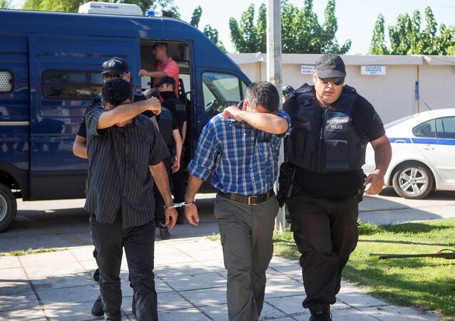 Two of the eight Turkish soldiers who fled to Greece in a helicopter and requested political asylum after a failed military coup against the government, are brought to prosecutor by two policemen in the northern Greek city of Alexandroupolis, Greece, July 17, 2016.