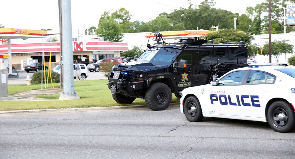 Police officers block off a road after a shooting in Baton Rouge, Louisiana, 17 July 2016.